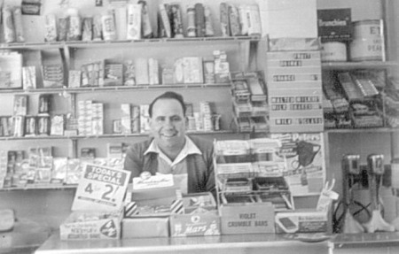 Annibale behind counter in the shop